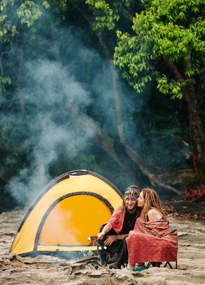 couple-making-smores-when-camping-in-forest-GYKKQGP.jpg