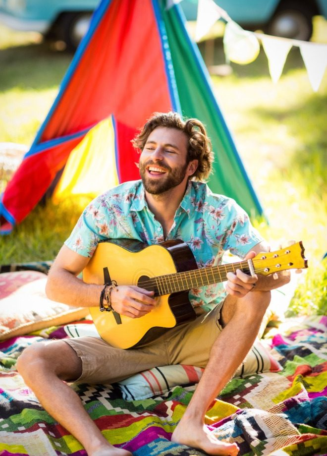 man-playing-guitar-at-campsite-CNVCZZA.jpg